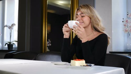 Portrait of Relaxed Young Woman Drinking Coffee