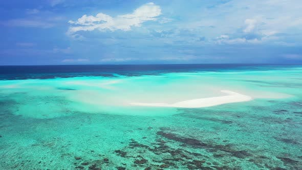 Luxury aerial copy space shot of a sandy white paradise beach and aqua turquoise water background