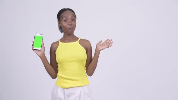 Thumbnail for Happy Young Beautiful African Woman Showing Phone and Talking