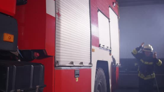 Male Firefighter Hurrying on Call