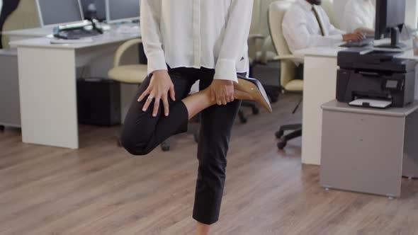 Businesswoman Stretching Her Legs