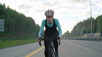 Determined Female Athlete Cycling