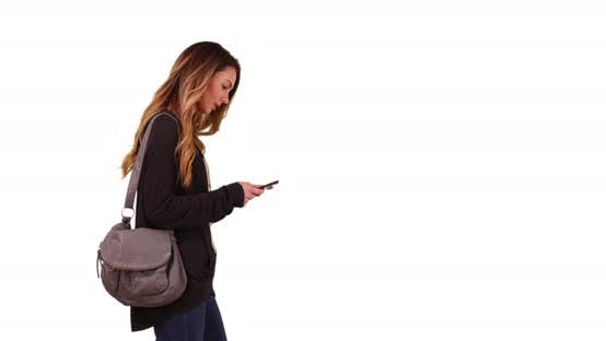 Thumbnail for White millennial girl texting on smartphone on white background with copy space
