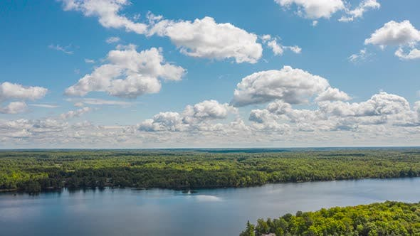 Thumbnail for Aerial Time Lapse Of Beautiful Summer Lake And Islands With Clouds Moving Fast 02