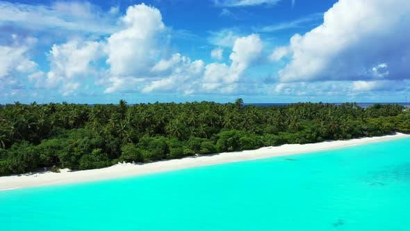 Thumbnail for Beautiful above abstract shot of a white sand paradise beach and turquoise sea background in 4K