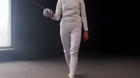 Cover Image for A Young Woman Fencer Walking To the Fighting Area and Starts the Duel
