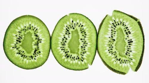 Crushing and Squeezing Three Kiwi Fruit Slices
