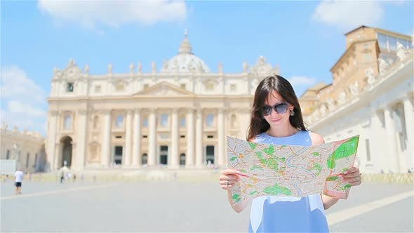 Thumbnail for Happy Young Woman with City Map in Vatican City and St. Peter's Basilica Church, Rome, Italy