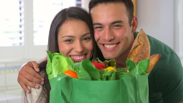 Thumbnail for Portrait of Mexican couple with grocery bag