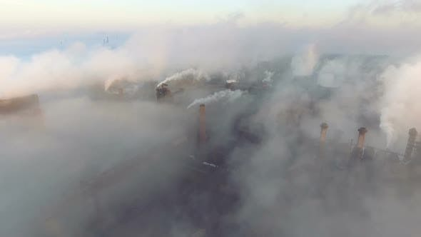 Thumbnail for Aerial View. Emission To Atmosphere From Industrial Pipes. Smokestack Pipes Shooted with Drone.