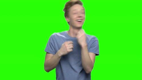 Portrait of Happy Teenage Boy Dancing