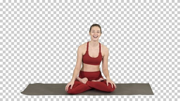 Beautiful Woman Sitting on Yoga Mat and Talking to Someone