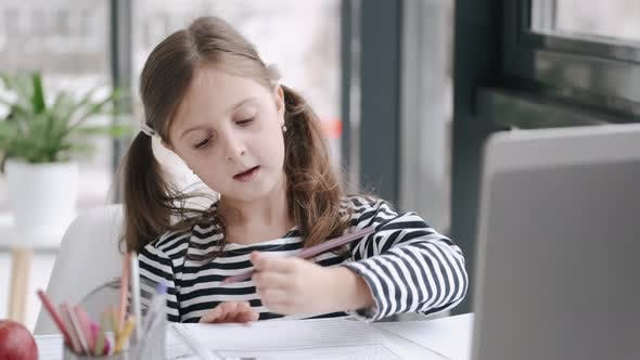 Thumbnail for Girl Studying with Video Online Lesson at Home Family in Isolation