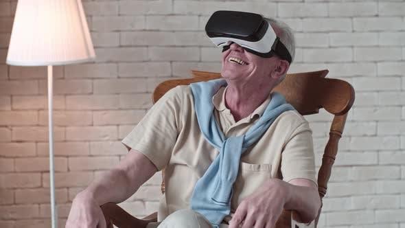 Thumbnail for Ecstatic Elderly Man in VR Goggles