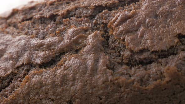 Thumbnail for Crackled browny type shiny cake surface close-up panning 4K 3840X2160 UltraHD footage - Tasty lookin