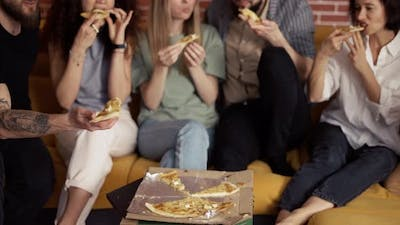 Male and Female Hands Taking Slices of Pizza From Food Delivery