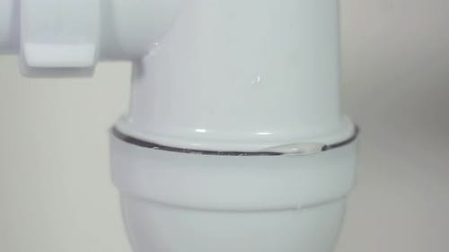 Close Up Leaking Siphon Under the Sink