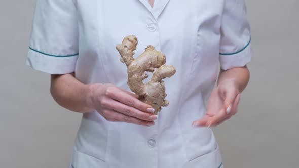 Thumbnail for Nutritionist Doctor Healthy Lifestyle Concept - Holding Ginger Root
