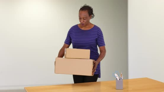 Thumbnail for A black woman receiving package delivery and brining it inside