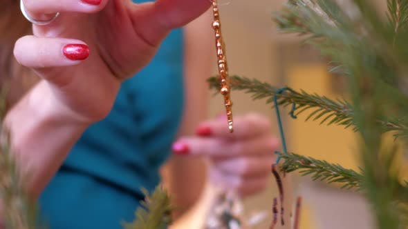 Slow Motion Closeup Gold Snowflake Hangs on Christmas Tree