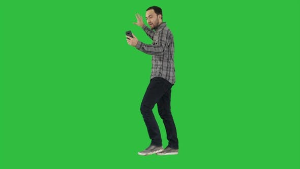 Thumbnail for Handsome bearded man recording vlog blog with smartphone