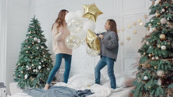 Thumbnail for Happy Ladies Playing with Star Balloons on Bed in Private House.
