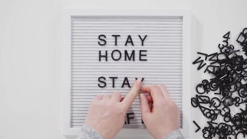 STAY HOME and STAY SAFE sign on message board.