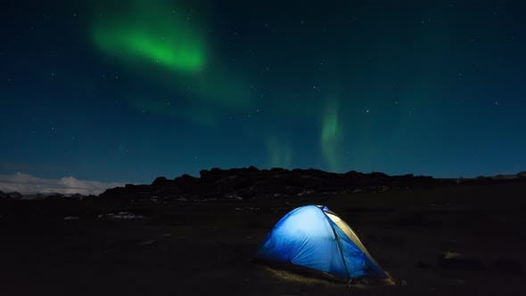 Tourist Tent on the Background of the Northern Lights - Aurora Borealis.
