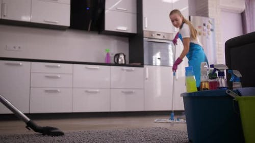 Staff of Cleaning Service During Work in Kitchen