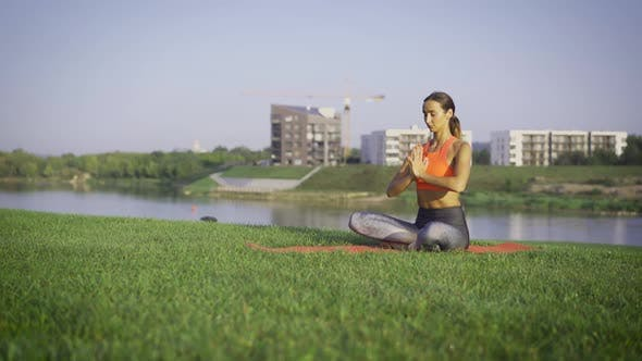 Healthy Woman Meditating Outdoor
