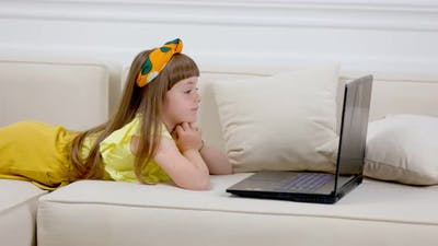 Rebecque Looking at Laptop