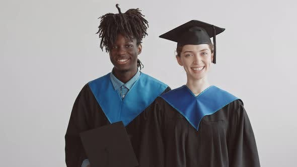 Portrait of Multi-Ethnic Graduate Students in Gowns