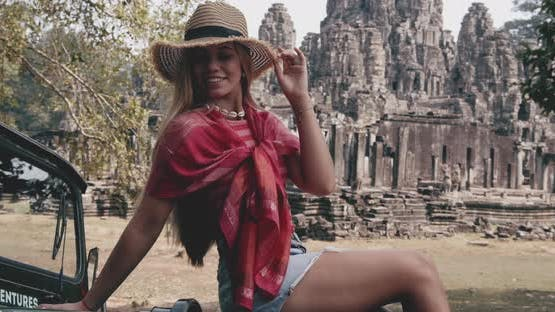 Wide Shot of a Female Model Posting at an Ancient Ruins