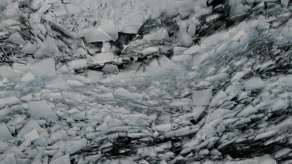 Thumbnail for Aerial View of a Frozen River. Fancy Ice Texture, Cold Chained Water. Shards of Ice Stick Out with