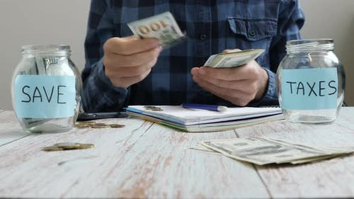 Saving money concept. Calculating money, accounting bills, putting money in jars