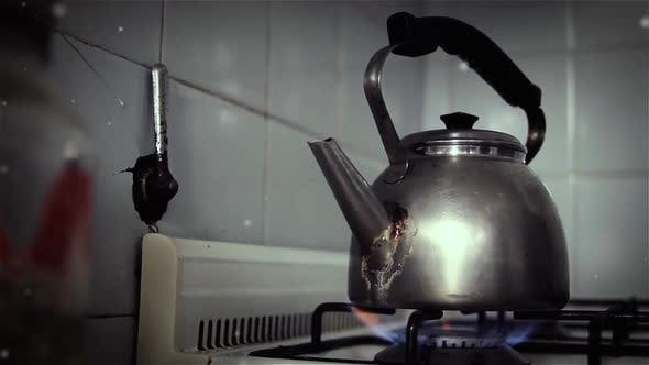 Old Tea Kettle on an Oven in the Kitchen.