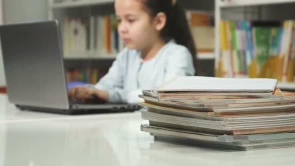 Thumbnail for Little Girl Using Laptop at School Studying Doing Homework