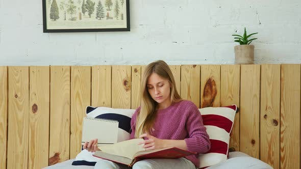 Thumbnail for Young Pretty Student Study Remote By Book in Bed