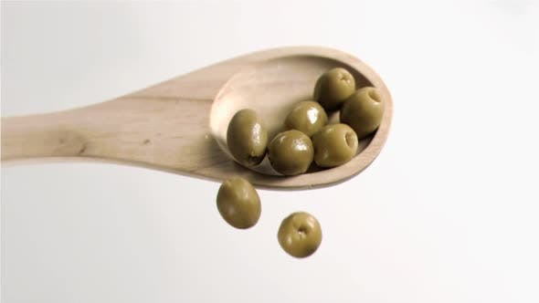 Thumbnail for Olives falling in super slow motion from the spoon