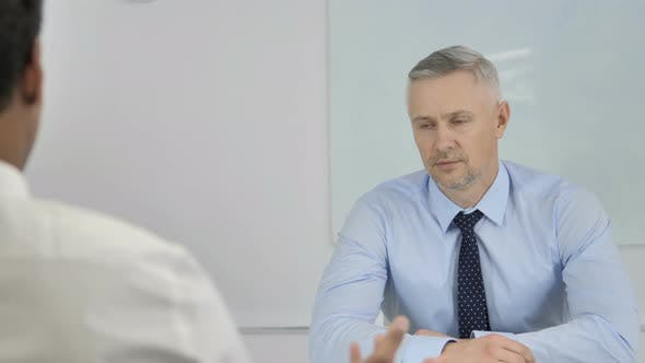 Thumbnail for Grey Hair Businessman Listening Employee at Work, Discussing Work