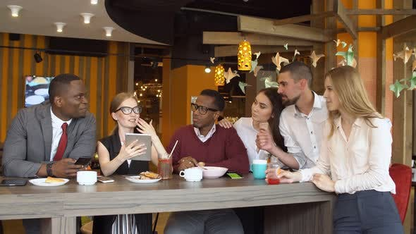 Thumbnail for Group of Young Mixed Race People in Coffee Shop.