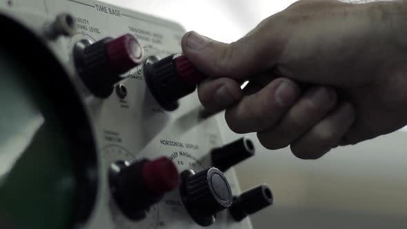 Thumbnail for Male Hand Operating Switches and Buttons on Control Panel.