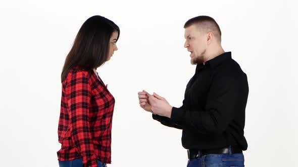 Thumbnail for Angry Man Yelling at the Woman and Shakes Her Shoulders. White