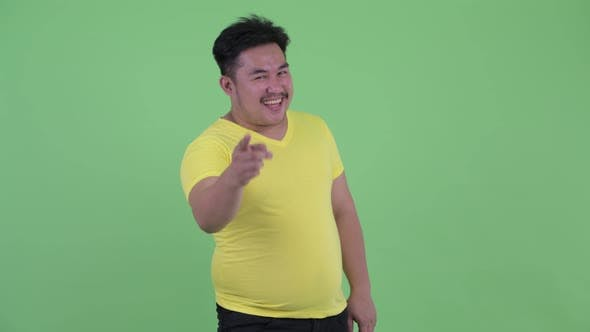 Thumbnail for Happy Young Overweight Asian Man with Fist Raised