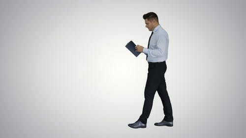 Young confused man trying to read smart book misunderstanding