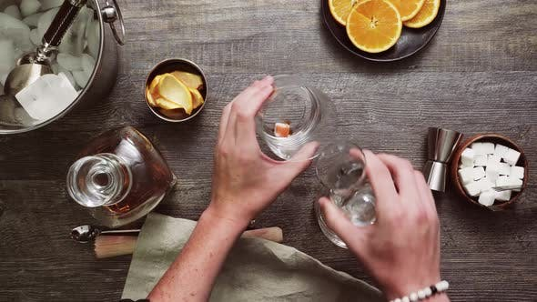 Step by step. Preparing Bourbon old fashioned cocktail at home bar.