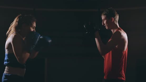 Thumbnail for Young Adult Woman Doing Kickboxing Training with Her Coach.