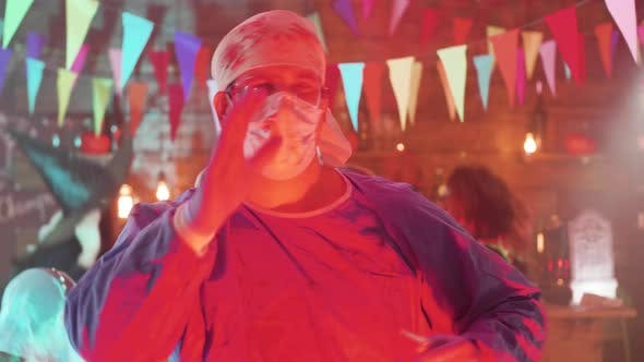 Thumbnail for Adult Male in Crazy Surgeon Halloween Costume Dancing at a Party