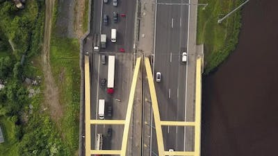 Aerial Vertical Shot. Cars Driving By the Road on the Bridge.