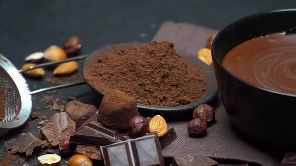 Cover Image for Ceramic Bowl of Chocolate Cream or Melted Chocolate, Nuts and Pieces of Chocolate